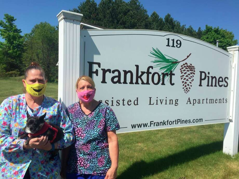 Sheryl Zilch (with Toby) and Deb Harrison, who both work at Frankfort Pines Assisted Living, have stayed in the facility for three months to ensure they don't contract COVID-19 outside of the workplace. (Courtesy photo)