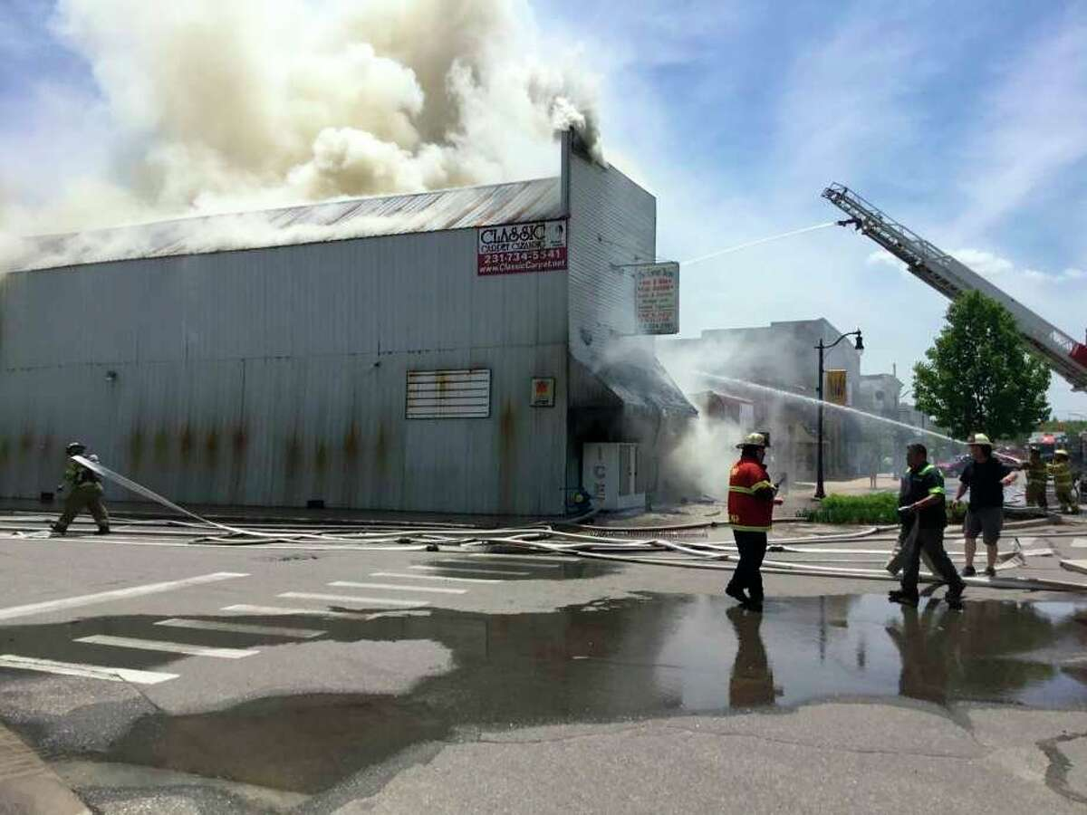 The Evart community is mourning the loss of one of its prominent stores. Evart Fire Chief Shane Helmer said firefighters were dispatched to a fire at the Corner Store shortly before 12:30 p.m. Wednesday. The cause of the fire remains unknown. (Herald Review photo/Alaina Modene)