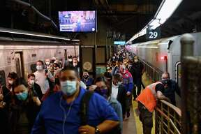 Commuters arrive at Grand Central Station with Metro-North during morning rush hour on June 8, 2020 in New York City.