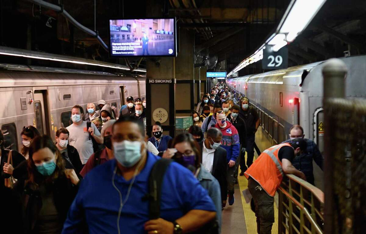 """Commuters arrive at Grand Central Station with Metro-North during morning rush hour on June 8, 2020 in New York City. - Today New York City enters """"Phase 1"""" of a four-part reopening plan after spending more than two months under lockdown. New York City is the final region in the state to reopen its economy. (Photo by Angela Weiss / AFP) (Photo by ANGELA WEISS/AFP via Getty Images)"""