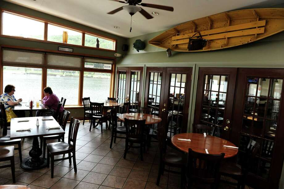 Health experts say outdoor dining is a safer option than indoors, but does that mean people should avoid eating inside restaurants? Not necessarily. Photo: File Photo / Connecticut Post
