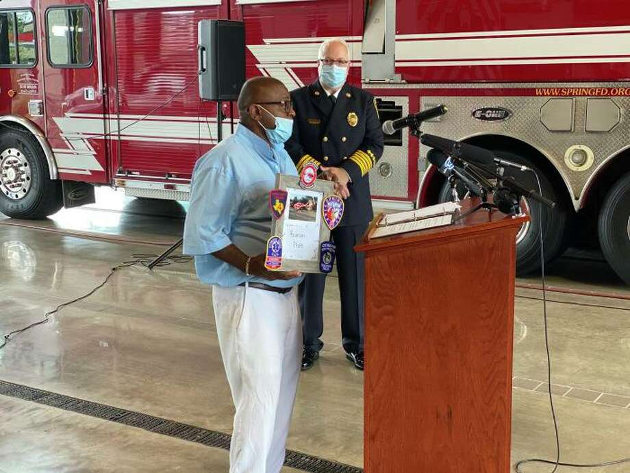 Vern Smith reunites with the first responders from Cypress Creek EMS and the Spring Fire Department who saved his life after he was shot with a shotgun in his car in February. Photo: Courtesy Of Cypress Creek EMS