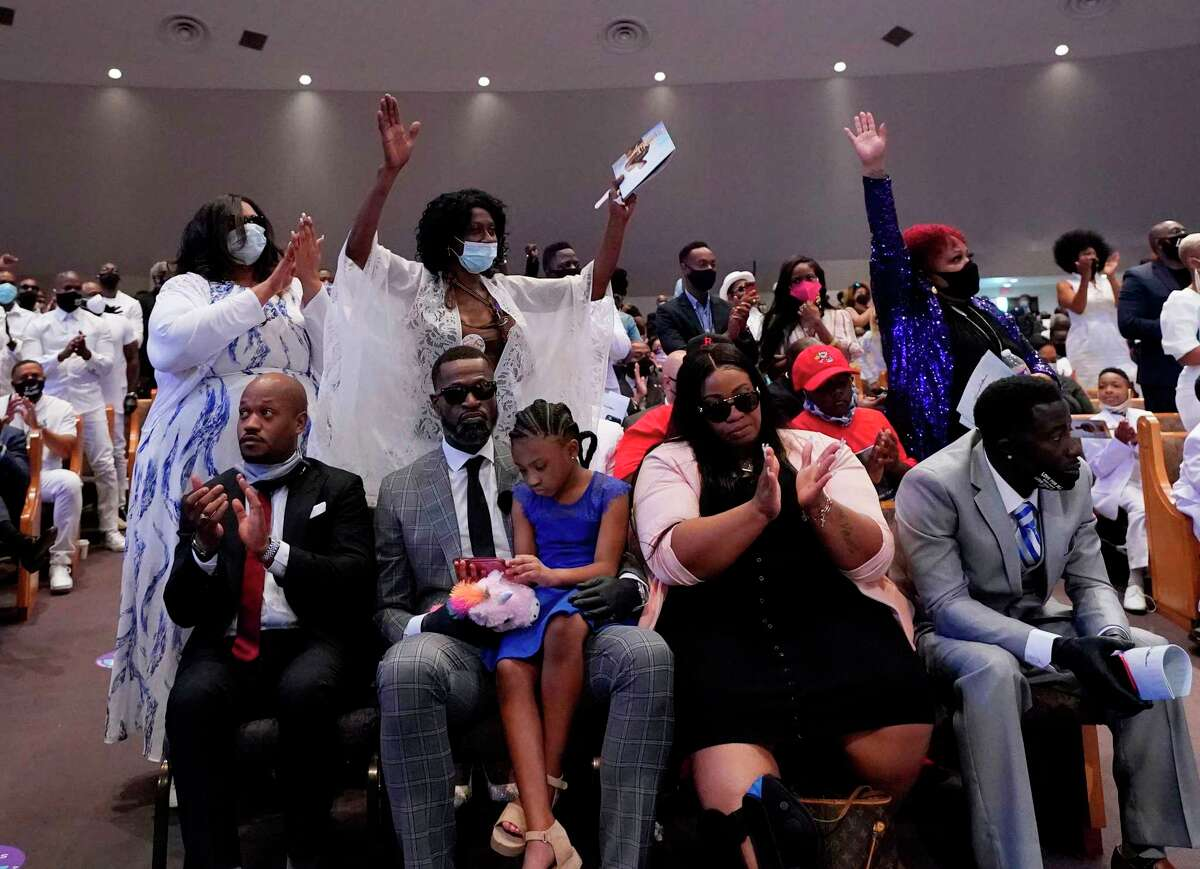 Family and guests attend the funeral service for George Floyd at The Fountain of Praise Church on Tuesday in Houston.