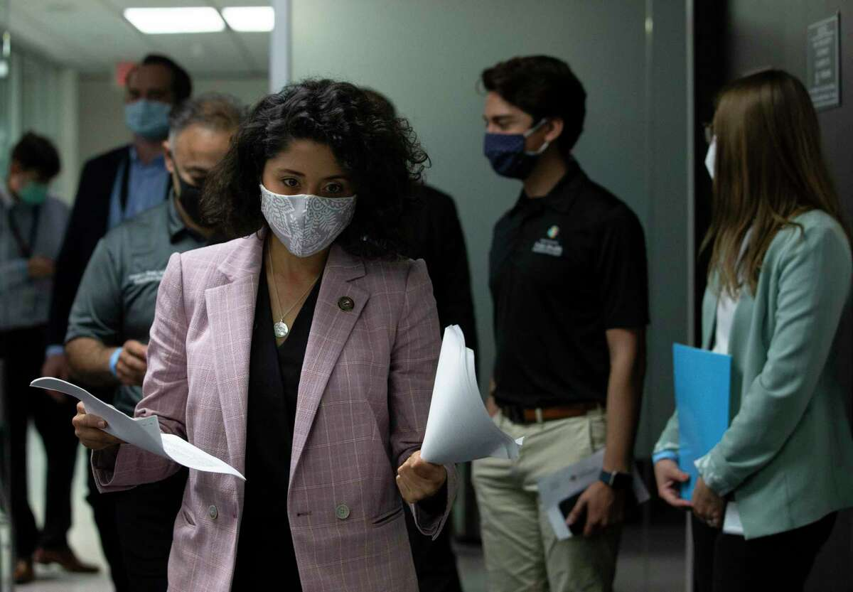 Harris County Judge Lina Hidalgo walks into the press conference room with the latest numbers of the day the Wednesday, May 13, 2020, at Harris County Public Health Department in Houston.