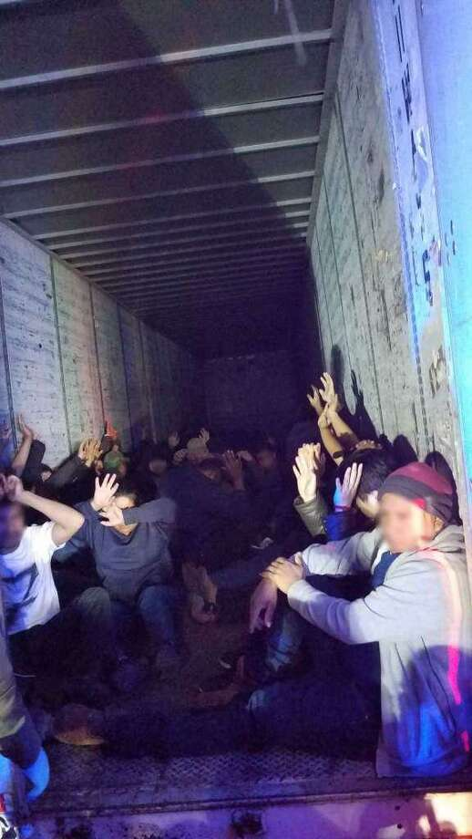 These are the 63 immigrants inside U.S. Border Patrol agents discovered inside a trailer on Jan. 21. The truck driver has pleaded guilty to conspiring to transport the immigrants. Photo: Courtesy Photo /U.S. Border Patrol