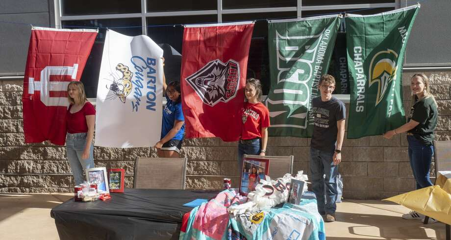 COM swimmers and divers stand with their college school flag 06/10/2020 morning in the courtyard at COM, Tarrin Gilliland, Indiana University, Sophia Ortiz, Barton College, Kristen Hepfer, University of New Mexico, Martin Knorr, Oklahoma Baptist University and Chloe Parker, Midland College. Tim Fischer/Reporter-Telegram Photo: Tim Fischer/Midland Reporter-Telegram
