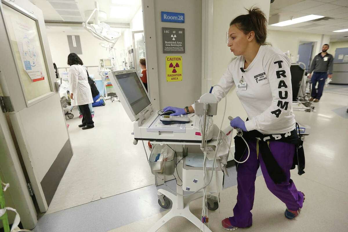 In a second round of grants, federal officials will divide $10 billion in funding between safety net medical centers like Houston's Ben Taub Hospital. Amanda Anderson, R.N., rushes equipment into the emergency room while staff examines a trauma patient at Ben Taub Hospital, a Trauma One Facility, on Thursday, July 9, 2015, in Houston. ( Mayra Beltran / Houston Chronicle )