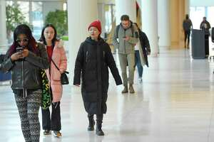 UConn Stamford students make their way between classes on Jan. 24, 2020. Social distancing and masks will be part of UConn's campus reopen plans.