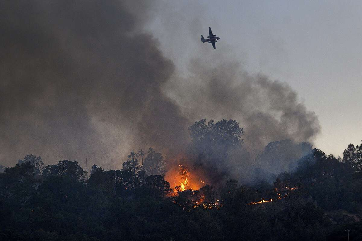 Flames from the Quail Fire burn along a hillside near Winters, Calif., on Saturday, June 6, 2020. (AP Photo/Noah Berger)