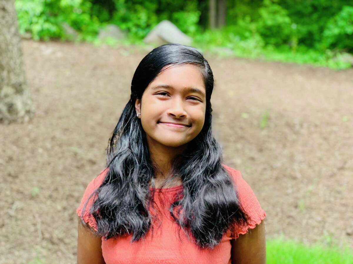 """Gayathri Kaimal, a ninth grader at Wilton High School, is the winner of the Wilton Woman's Club's essay contest. Her short story, """"Sisterhood,"""" touched on the struggle for the 19th Amendment as well as racial equality."""