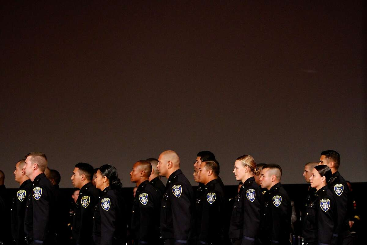 A graduating class of new Oakland Police Department cadets in 2014. Following days of protests against police brutality, an expert argues that reforming policing is still possible, especially with changes to new officer training.
