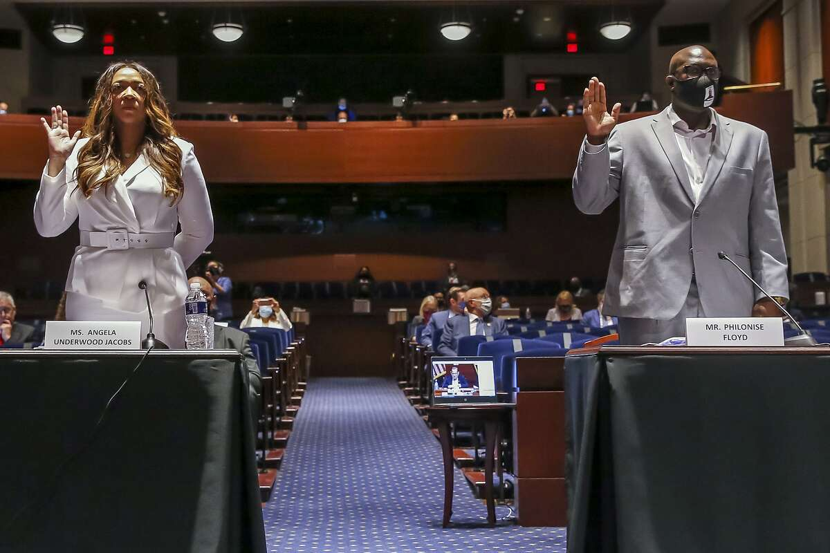 Angela Underwood Jacobs, a Lancaster, Calif., city council member, left, and Philonise Floyd, a brother of George Floyd, are sworn in during a House Judiciary Committee hearing on proposed changes to police practices and accountability on Capitol Hill, Wednesday, June 10, 2020, in Washington. (Michael Reynolds/Pool via AP)