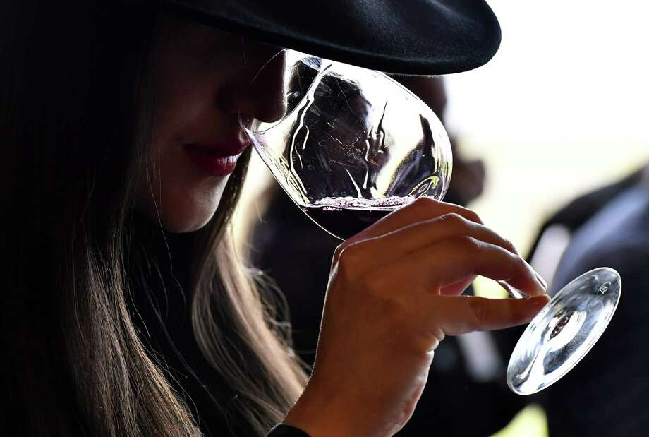 Empty Glass in Tomball will host a wine tasting event June 10. In this file photograph taken on April 10, 2018, a woman tastes red wine during a wine tasting session at the Chateau La Dominique in Saint-Emilion, south-western France, during the 'Semaine des Primeurs' to present wines from the Bordeaux region. Photo: GEORGES GOBET, Contributor / AFP Via Getty Images / AFP or licensors