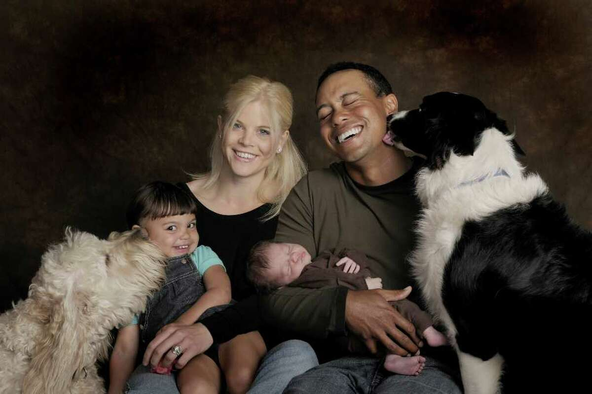 In this handout from the Tiger Woods family, (L-R) Sam, Elin, Tiger, Charlie Woods and their dogs Yogi and Taz pose for a family photo on February 17, 2009 in Orlando, Florida. Charlie Woods was born on February 8, 2009. (Photo by Dom Furore/Woods Family via Getty Images)
