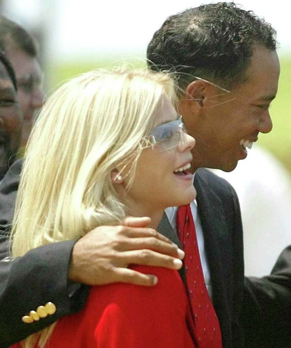 Tiger Woods and his girlfriend Elin Nordegren during the opening ceremony of the Presidents Cup 2003 Golf Tournament at the Fancourt Golf Estate in George, South Africa on Nov. 20, 2003 file photo. Woods and Nordegren were engaged after the tournament (AP Photo/Obed Zilwa, file)