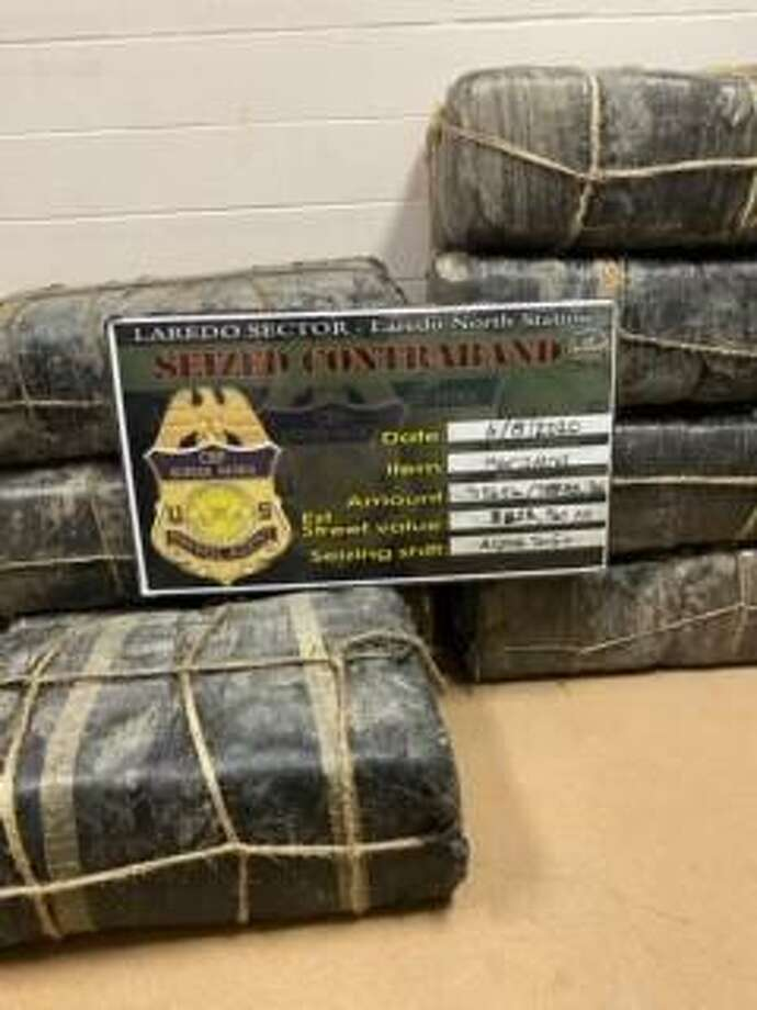 U.S. Border Patrol agents said they found these abandoned bundles of marijuana near the riverbanks in west Laredo. The contraband weighed 785.9 pounds and had an estimated street value of $628,760. Photo: Courtesy Photo /U.S. Border Patrol