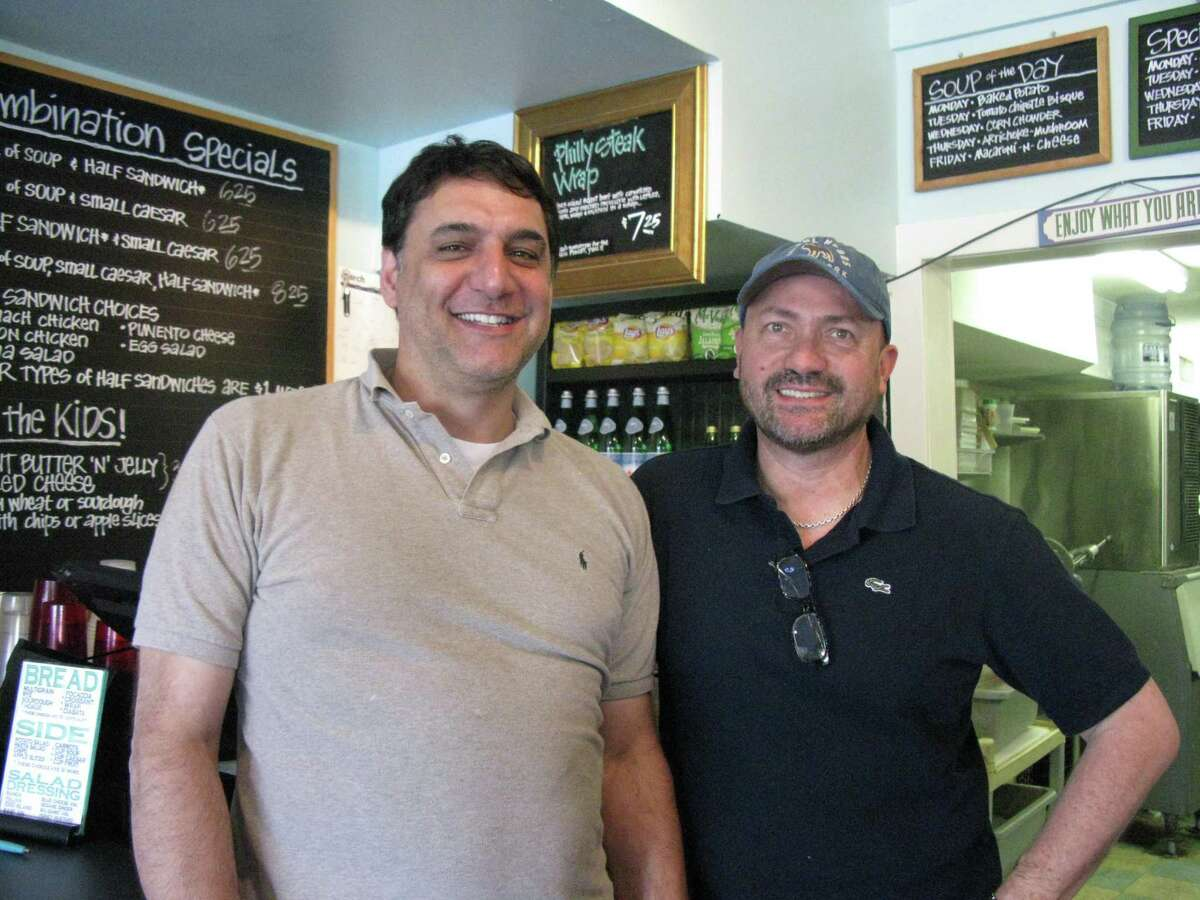 W.D. Deli co-owners Wayne Beers (left) and Michael Bobo are selling their Broadway restaurant after 30 years in business.