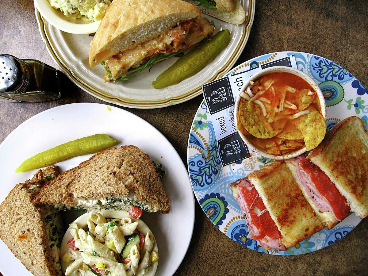 W.D. Deli on Broadway is for sale after 30 years in business. Their menu includes a chicken chipotle Parmesan sandwich with potato salad, top left, an Italian panini with chicken tortilla soup and a spinach chicken salad sandwich with pasta salad.