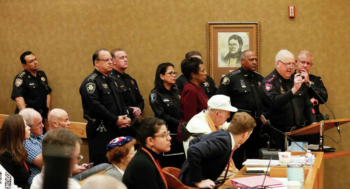 Harris County Sheriff Ed Gonzalez (left) and other constables stand in support as Harris County Constable Mark Herman expressed his feelings regarding a proposed study during the Harris County Commissioners Court Tuesday, March 10, 2020, in Houston.