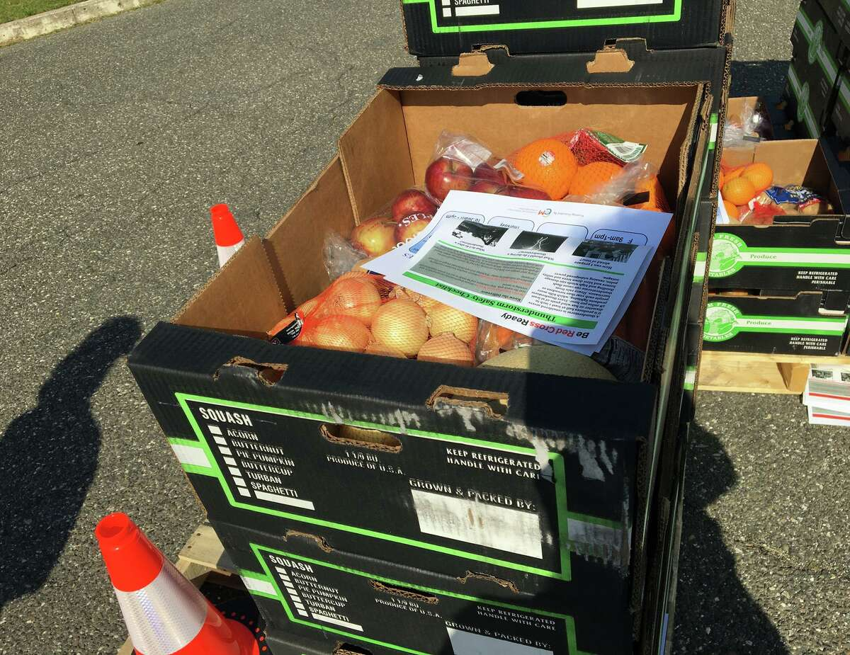 Boxes of produce given away Wednesday by the Friendly Hands Food Bank at Torrington Middle School. The event was scheduled for 8 a.m. until noon. The food ran out at 10.