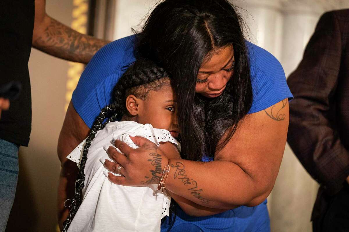 George Floyd's daughter Gianna Floyd, 6, gives her mother Roxie Washington a hug during a press conference on Tuesday, June 2, 2020 at Minneapolis City Hall.