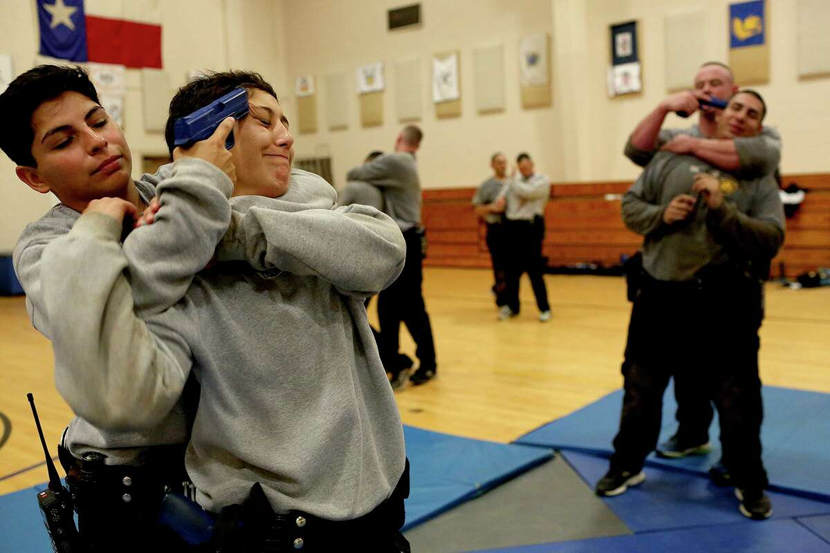 Jocelyne Alvarez, left, and Alyssa Hernandez participate in a training exercise at the San Antonio Police Training Academy on June 29, 2017. San Antonio police officers are allowed to place a suspect in a potentially deadly chokehold as a last resort, though the maneuver is not taught by instructors and it is highly discouraged.