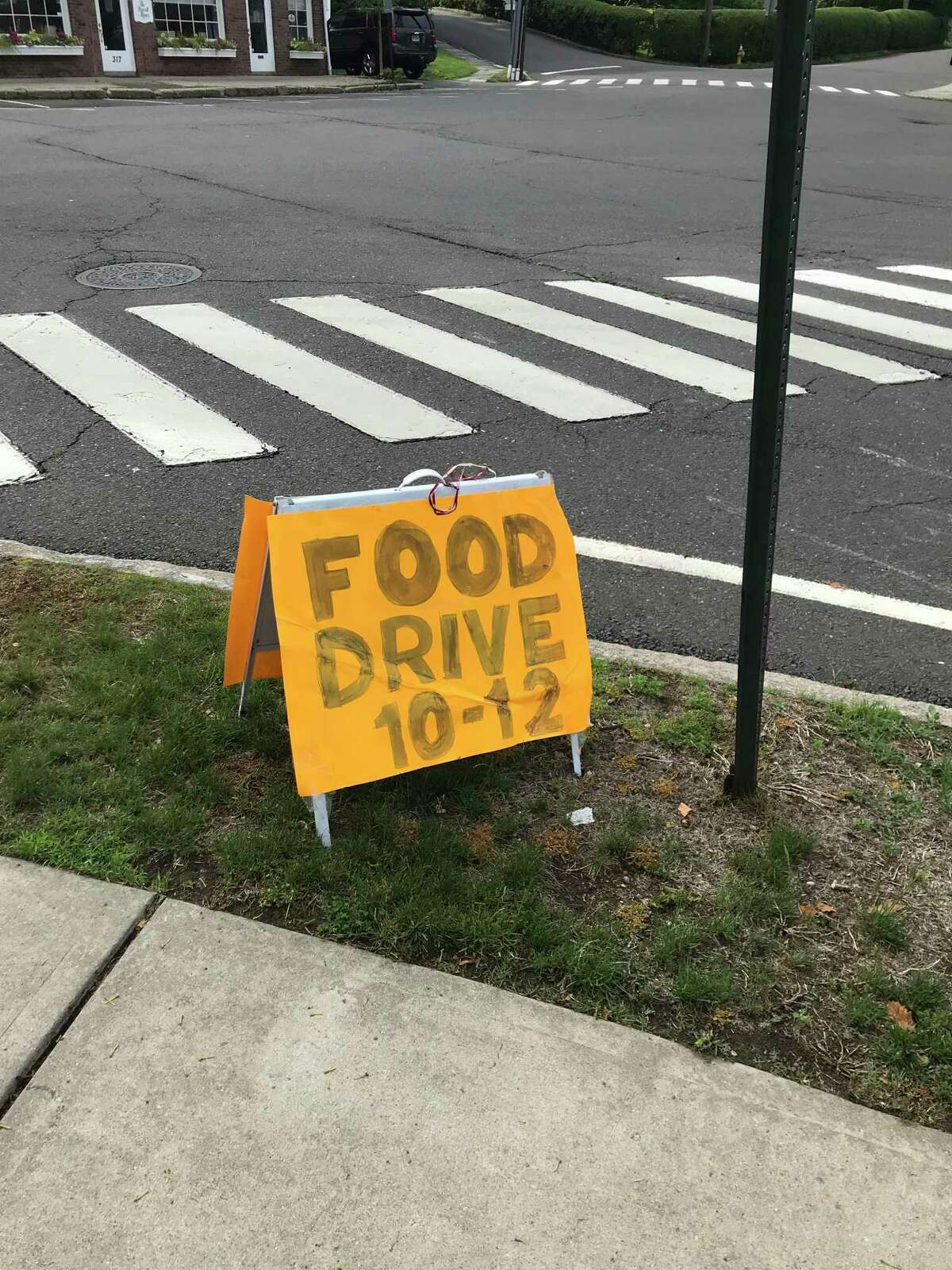 The sign put near the parking lot of Chase Manhattan Bank for the June 6 food drive.