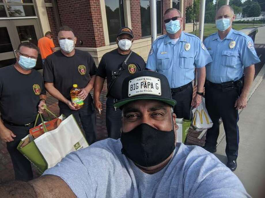 Greg Horta takes a selfie with local first responders in front of the Edwardsville Public Safety Building. Photo: Courtesy Of Greg Horta
