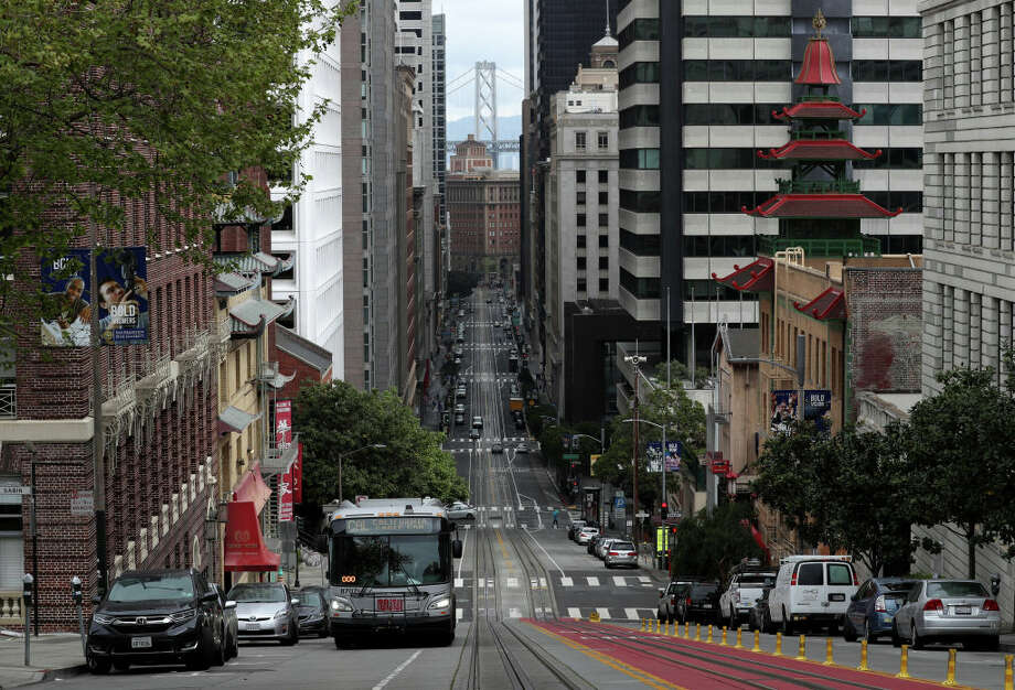 FILE.- A San Francisco MUNI bus travels along an empty California Street during the coronavirus (COVID-19) pandemic on April 6, 2020. Shortly after the SFMTA announced they would no longer transport police officers to protests, the SFPOA lashed back on social media. Photo: Justin Sullivan/Getty Images / 2020 Getty Images