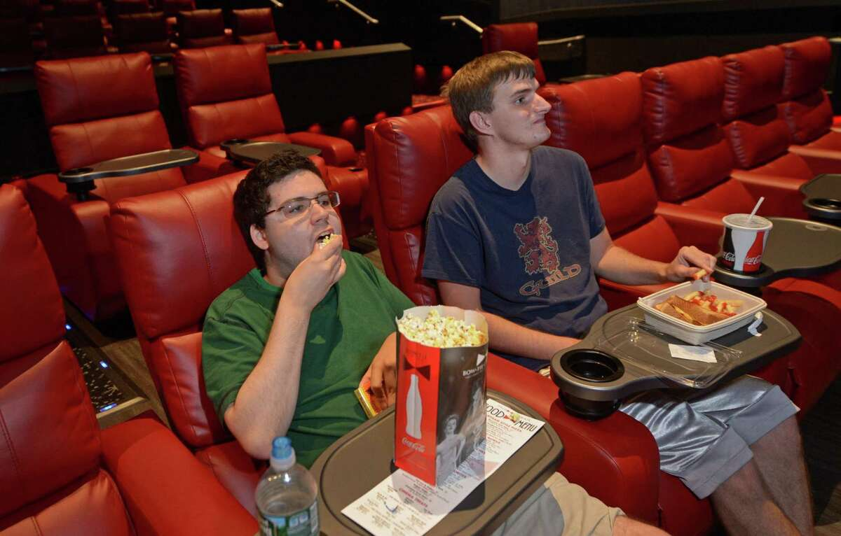 Moviegoers in 2017 at Bow Tie Cinemas Ultimate Royale 6 theater on Westport Avenue in Norwalk, Conn. Bow Tie is allowing customers to remove face masks during movies, while requiring their use in lobbies and restrooms to decrease any chances of the spread of COVID-19.