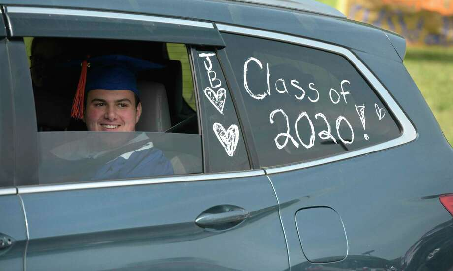 Jackson Scott Benz waits in a SUV to take part in the 2020 Danbury High School graduation, Wednesday, June 10, 2020, at Danbury High School, Danbury, Conn. Graduation is taking place over three days, June 10, 11, and 12. Photo: H John Voorhees III / Hearst Connecticut Media / The News-Times