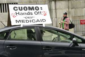 "Dan Plaat, secretary of local Green Party, plays the saxophone while a parade of cars circle the New York State Capitol honking their horns with signs such as ""Cuomo: Hands Off our Medicaid"" on Wednesday, June 10, 2020 in Albany, N.Y.  (Lori Van Buren/Times Union)"