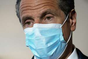 Gov. Andrew Cuomo wears a mask during a news conference at Laguardia Airport's Terminal B, Wednesday, June 10, 2020 in New York. The new terminal will open Saturday, June 13.