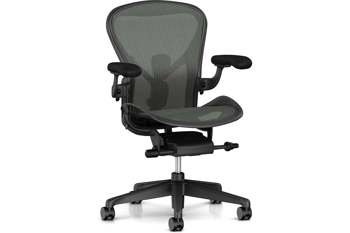 Ergonomic Desk Chairs The chair you use can have a huge impact on your posture, since it can encourage a seated posture that protects your spine and key muscles. Unfortunately, a high-end desk chair is also going to cost you: this highly rated and well-reviewed Herman Miller Aeron Ergonomic Office Chair costs $1,395 on Amazon Prime. It comes with a 12-year guarantee and seems widely beloved, but it still costs $1,395, which is about $1,300 more than most people want to spend on a chair. For a more budget-friendly ergonomic desk chair, MyErgonomic Desk Chair recommends the Flash Furniture Mid-Back Black Mesh Swivel Ergonomic Task Office Chair ($119.86 on Amazon). If you're on a tighter budget than that, you can also see results by taking your ordinary, non-ergonomic desk chair and adding cushioning ($48.95 on Amazon).