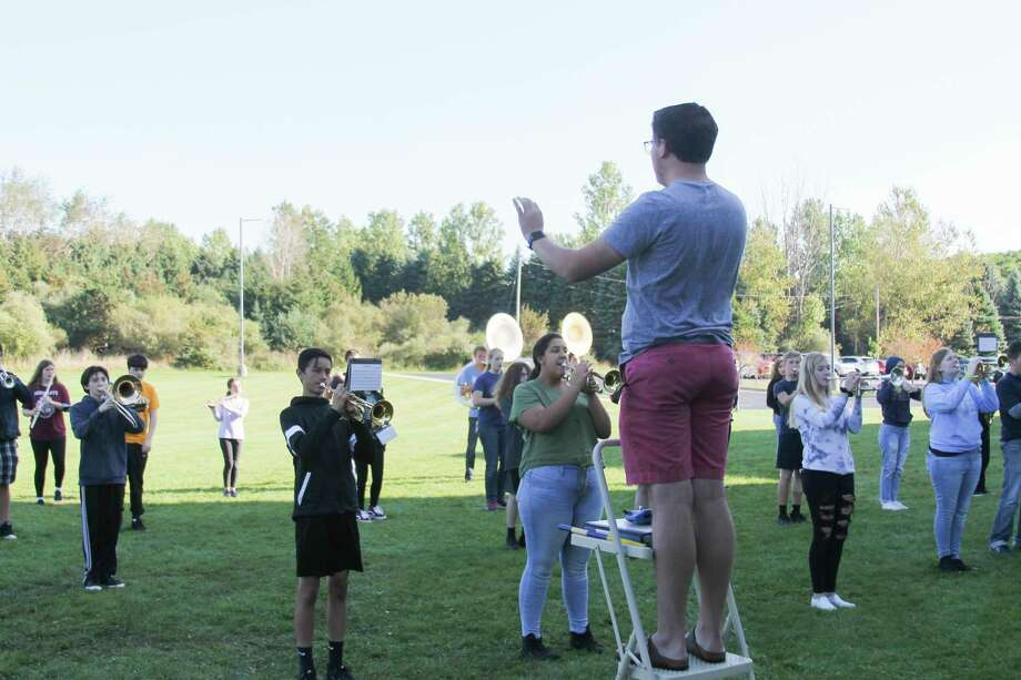 Student director Ryan Biller leads the Manistee High School Marching Band in a practice session in September 2019 for the Cadillac Marching Band Exhibition. Biller is looking to start his second year as the musical director of the Manistee Community Band; he is looking for area musicians to join the group. (File photo)