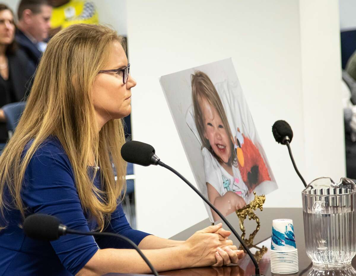Jacqueline Franchetti testifying before the Assembly Judiciary Committee last October next to a photo of daughter, Kyra. The 2-year-old was murdered in 2016 by Franchetti's ex-boyfriend, Roy Rumsey, who then torched his home and killed himself.