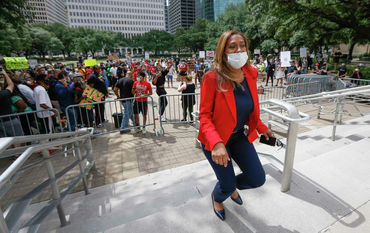 Council Member at Large 4 Letitia Plummer heads back to City Hall after she addressed a rally to report the City Council voted against amendments to eliminate police misconduct to the city budget Wednesday, June 10, 2020, in Houston.