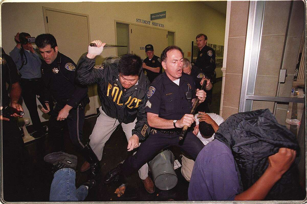 PROTEST 3/C/28APR97/CD/LS----Campus police beat on Prop 209 protesters after they had tried to take over Sproul Hall. Photo By Lea Suzuki