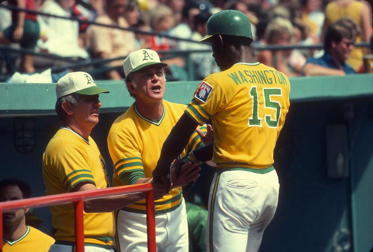 MINNEAPOLIS, MN - CIRCA 1976: Manager Chuck Tanner #7 of the Oakland Athletics congratulates Claudell Washington #19 after he scored against the Minnesota Twins during an Major League Baseball game against the circa 1976 at Metropolitan Stadium in Minneap