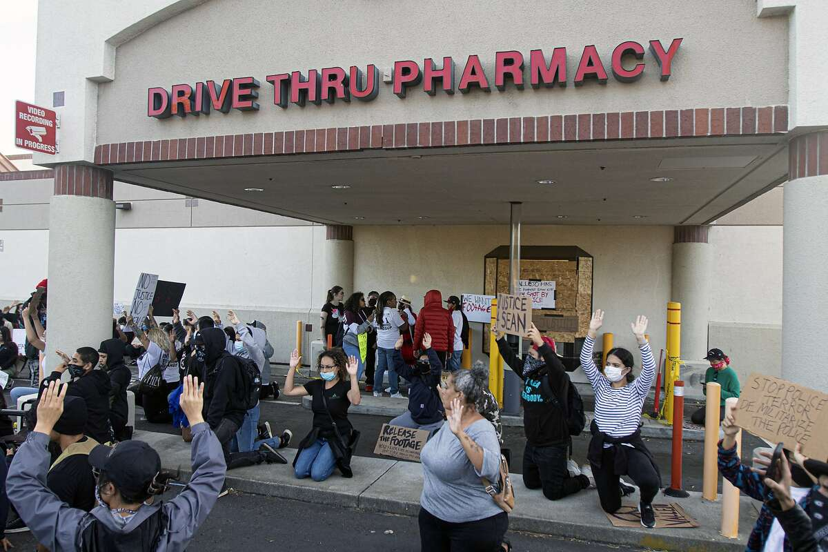 A group of protesters at the Walgreens where Sean Monterrosa was shot and killed by a Vallejo police officer earlier in the week in Vallejo, Calif., Friday, June 5, 2020
