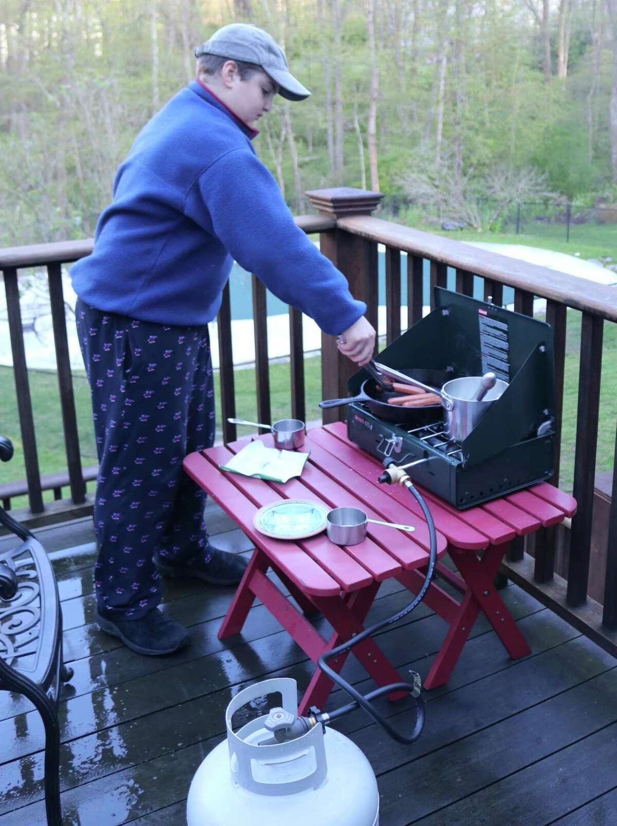 Outdoor cooking was among the skills Boy Scouts in New Canaan Boy Scout Troop 70 honed when they held a virtual campout recently amid the coronavirus pandemic. They also came together online to share their experiences.