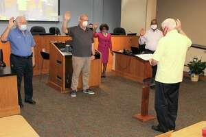 Municipal Judge Ed Phillips (far right) swears in members of the Live Oak City Council during its May 26 meeting. From left are Councilman Ed Cimics, Councilman Bob Tullgren, Mayor Mary Dennis and new appointed Councilman Ramon Norris Jr. Cimics, Tullgren and Dennis were re-elected without opposition in May.
