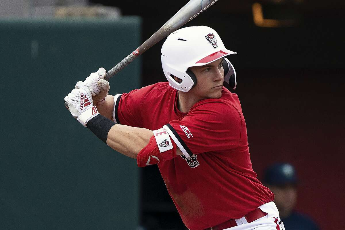 FILE - In this Feb. 25, 2020, file photo, North Carolina State's Patrick Bailey (5) bats during an NCAA baseball game on in Raleigh, N.C.