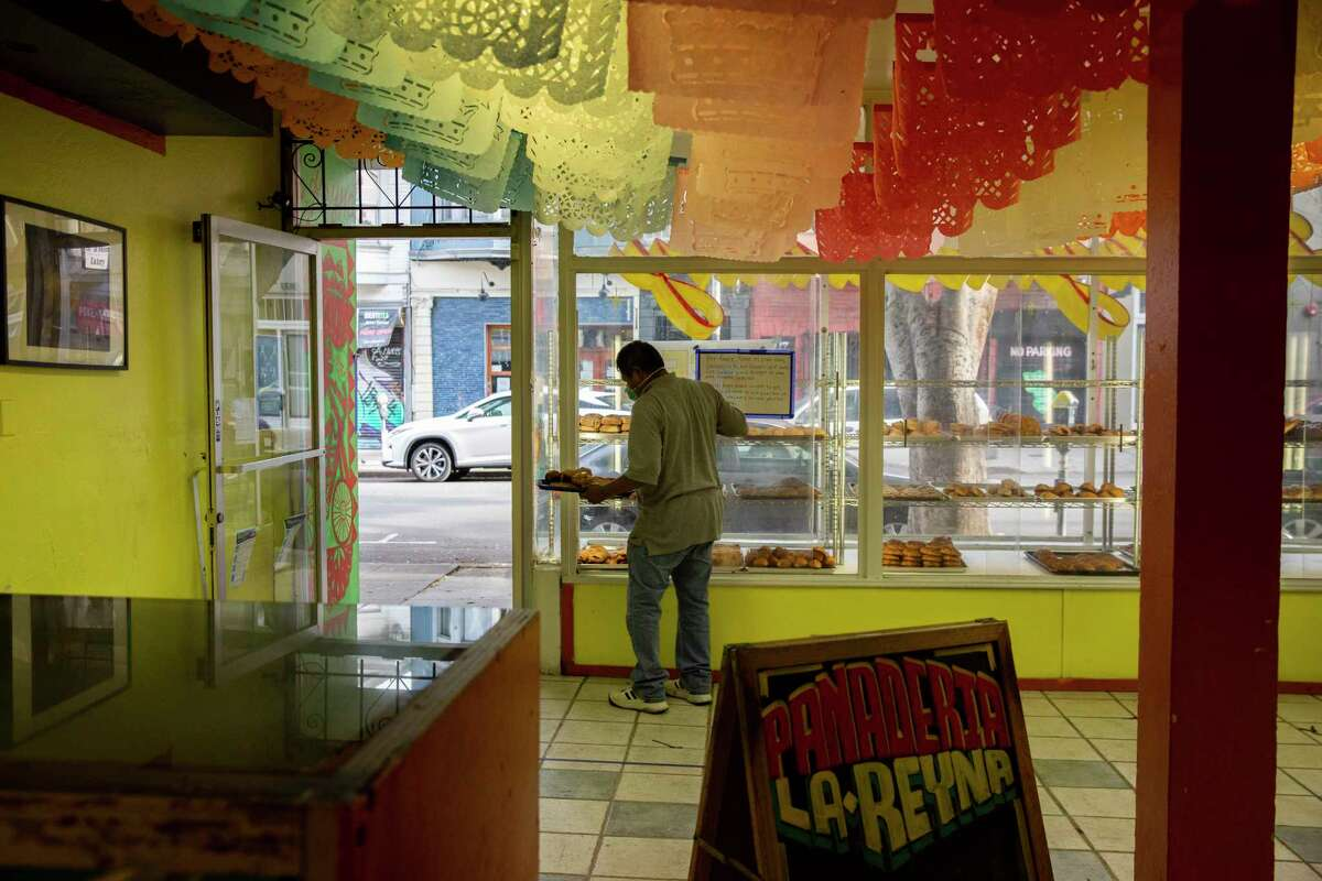 Customer Rigoberto Diaz picks up bread at La Reyna Bakery in San Francisco. In a letter to Mayor London Breed, nearly three dozen advocacy groups urged the mayor to address the social inequities that have made Latinos particularly vulnerable to COVID-19.