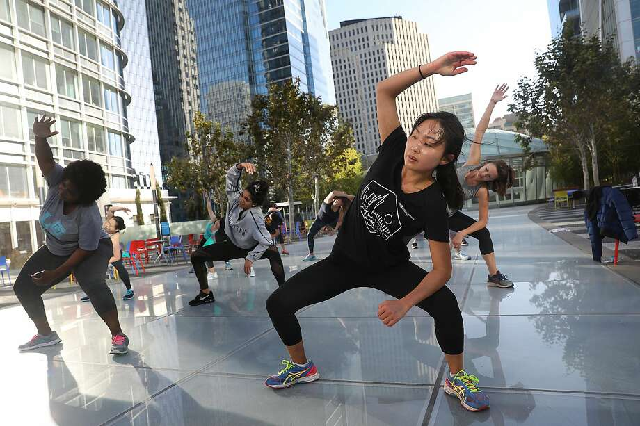 A free cardio zumba dance class offered by Fitness SF on the rooftop Salesforce Park in 2018. Photo: Liz Hafalia / The Chronicle
