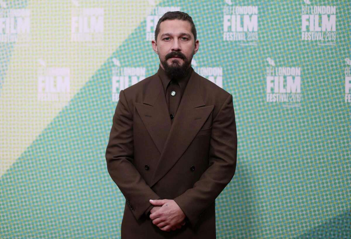 """FILE - In this Oct. 3, 2019 file photo, Shia LaBeouf poses for photographers at the premiere of """"The Peanut Butter Falcon"""" during the London Film Festival. LaBeouf turns 34 on June 11. (Photo by Vianney Le Caer/Invision/AP, File)"""