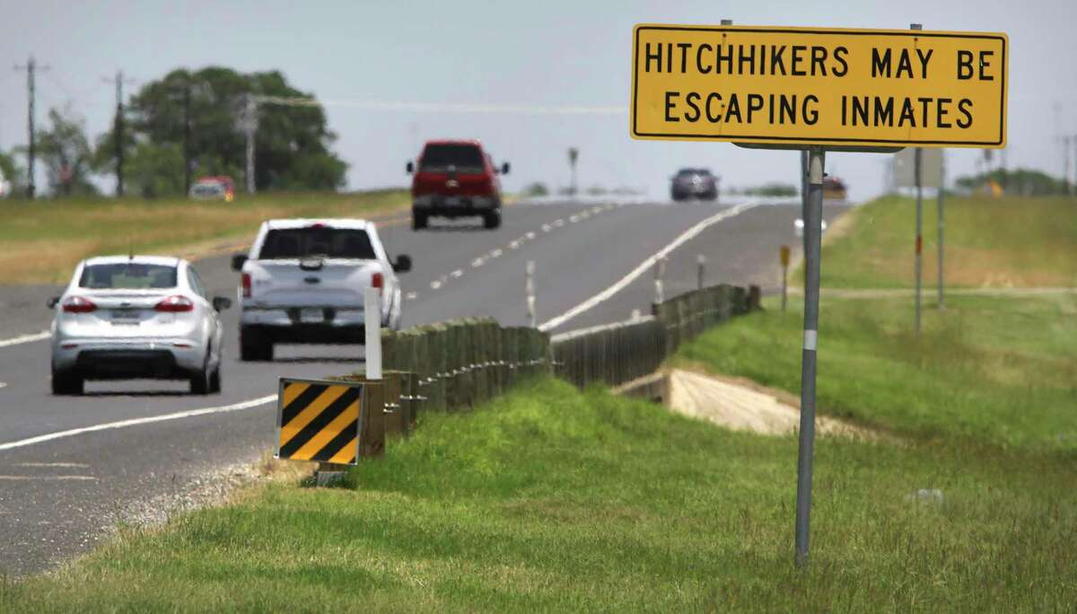A sign on U.S. 90 west of Hondo warns drivers about prisoners from two area prisons, on Wednesday, June, 10, 2020.