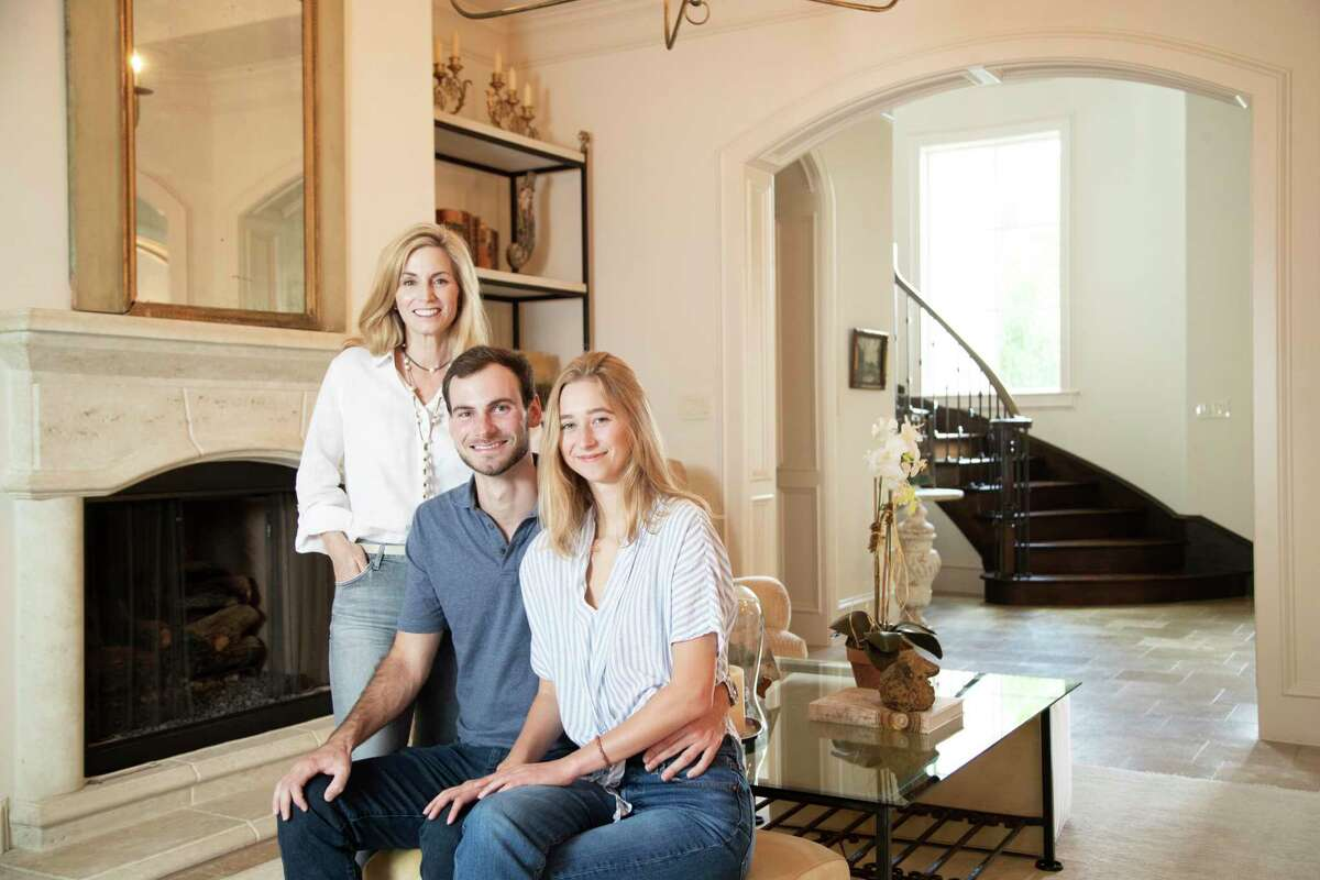 Cammy Johnson, her son Parker Johnson, 23, and Edie Wlison, 20, at Cammy's home on Saturday, June 6, 2020, in Houston. Cammy, helped Edie set up an operation to remove a six-centimeter mass on Edie's neck, and stayed with her overnight at Houston Methodist after the procedure.
