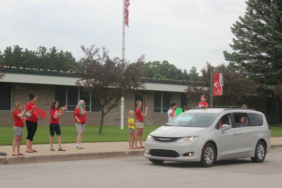 Crystal Lake Elementary staff members cheer on their fifth graders during an end of the school year parade at Benzie Central High School. Photo: Robert Myers
