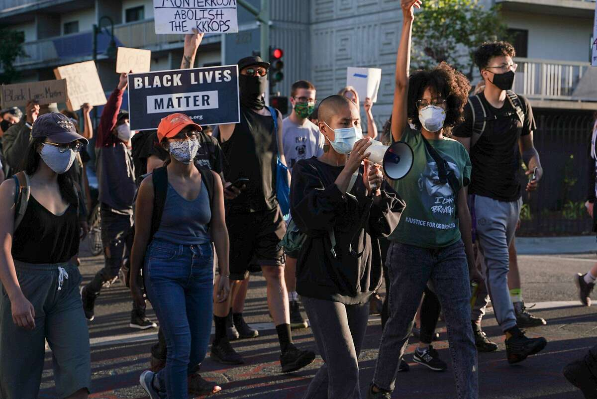Demonstrators march during a youth led protest to defund the Oakland Police Department in Oakland, Calif., on Wednesday, June 10, 2020.